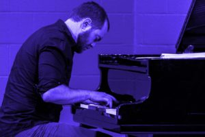 lars at the piano in blue